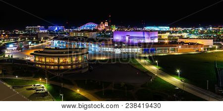 Night Aerial Panoramic View Of Illuminated Streets And Buildings Of Adler, Sochi, Russia