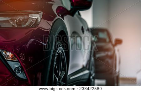 Red New Luxury Suv Compact Car Parked In Modern Showroom For Sale. Car Dealership Office. Car Retail