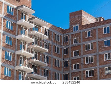 Multi-storey Building. Construction Of Multi-storey Residential Building. Windows And Balconies On T