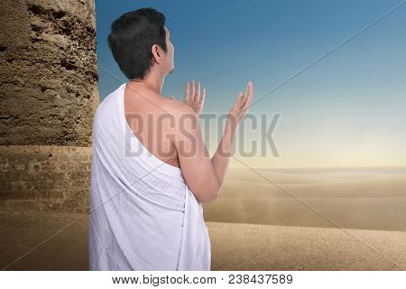 Back View Of Asian Pilgrim Man Praying To Allah In Outdoor
