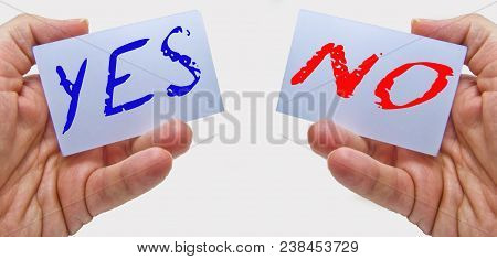 Businessman Showing Yes (in Blue Color) And No (in Red Color) Cards In His Hands