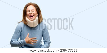 Injured woman wearing neck brace collar confident and happy with a big natural smile laughing isolated blue background