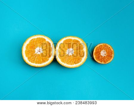 Citrus Fruit Flat Lay Two Halves Of Orange And Half Of Mandarin Are Lying In A Row On Bright Blue Ba