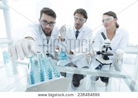 Portrait of a group of researchers conducting research
