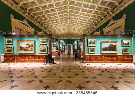 Saint Petersburg, Russia - March 16, 2018: Tourists In Gallery Of Great Hermitage Museum. The State