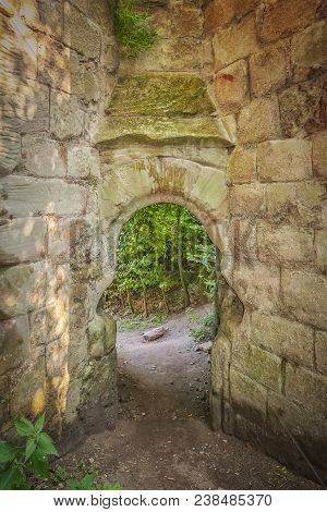 Heavily Fortified Castle Ruins Located On A Dramatic Promontory Overlooking The River Esk.