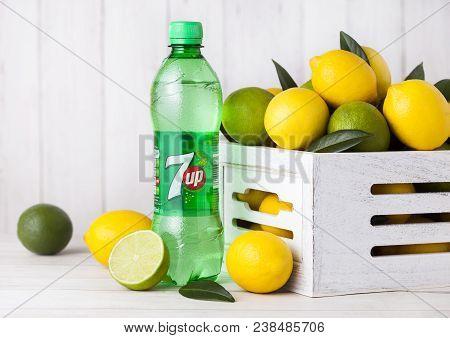 London, Uk - April 27, 2018: Plastic Bottle Of 7up Lemonade Soda Drink With Fresh Lemons And Limes.t