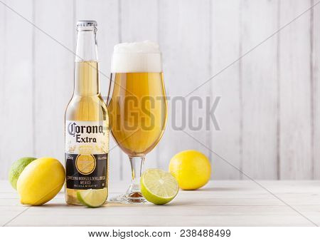 London, Uk - April 27, 2018: Bottle Of Corona Extra Beer On Wooden Background With Fresh Lemons And