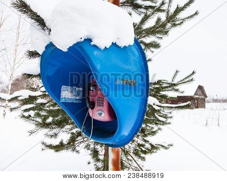 Fedosovo, Russia - February 24, 2018: Outdoor Telephone Booth In Snow Field In Village. Working Publ