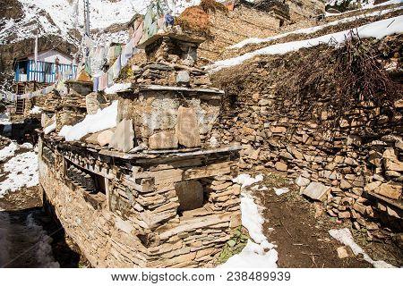 Ancient Tibetan Buddhist Chorten In Upper Pisang Village In The Annapurna Region, Nepal, Manang Dist