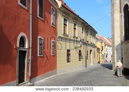 Gyor, Hungary - August 10, 2012: People Visit Old Town In Gyor, Hungary. In 2011 Tourism Receipts In