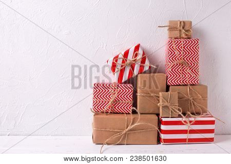 Wrapped Colorful Gift Boxes With Presents  On White Textured Background. Selective Focus. Place For