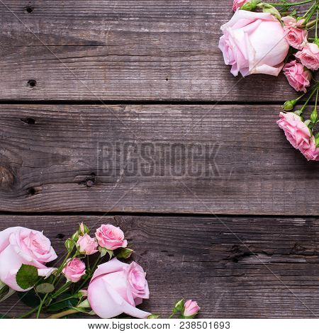 Frame From  Pink Roses Flowers  On  Aged Wooden Background. Floral Still Life.  View Frome Above. Se