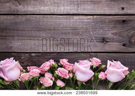Border From  Pink Roses Flowers  On  Aged Wooden Background. Floral Still Life.  View Frome Above. S