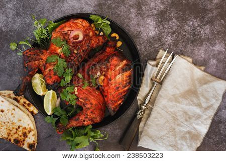 Indian Tandoori Chicken With Naan, Lime Slices And Cilantro, Ready To Eat. Top View, Blank Space