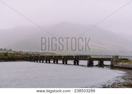 Scenic View Of Old Valentia River Viaduct In The Wild Atlantic Way Of Ireland Against Mountains And