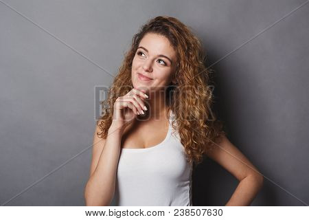 Portrait Of Thoughtful Redhead Woman With Mysterious Look. Pensive Girl Touch Her Chin And Dreaming,