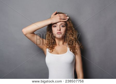 Attractive Redhead Girl Touching Her Forehead, Might Be Sick. Young Woman Check Her Body Temperature