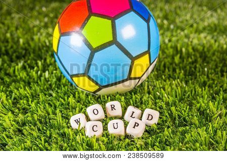 Barcelona, Spain, April 2018:football Ball And World Cup Phrase Formed By Wooden Letters Over Green