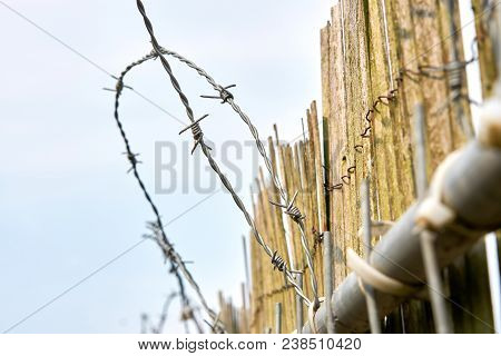 Barbed Wire As Protection Against Burglars On A Fence