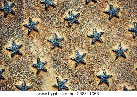 Embossed Star Shapes On Rusty Metal Surface, Worn Metallic Texture As Background