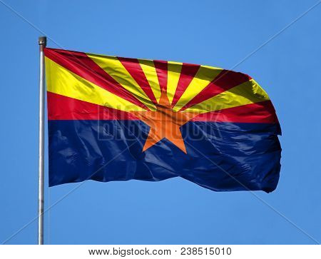 National Flag State Of Arizona On A Flagpole In Front Of Blue Sky.
