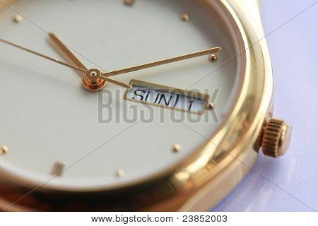 Golden watch sunday day