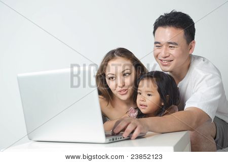 Asian Family Using The Laptop