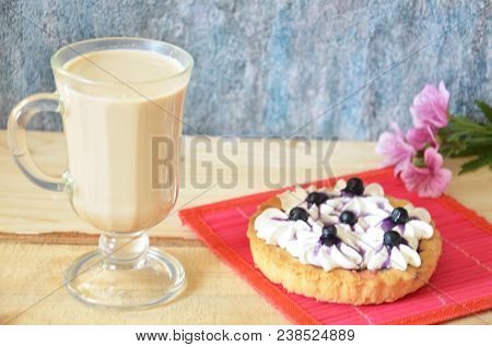 Irish Coffee With Tart Or Cake With Cream And Blueberries