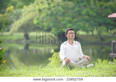 Asian Man Meditating