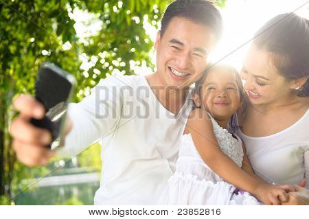 Asian Family Taking Photographs