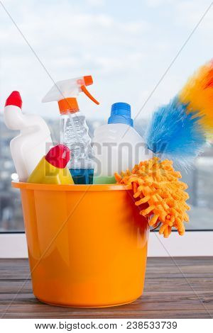 Bucket With Cleaning Supplies. Cleaning Supplies Kit On Window Background. Cleaning Service Concept.