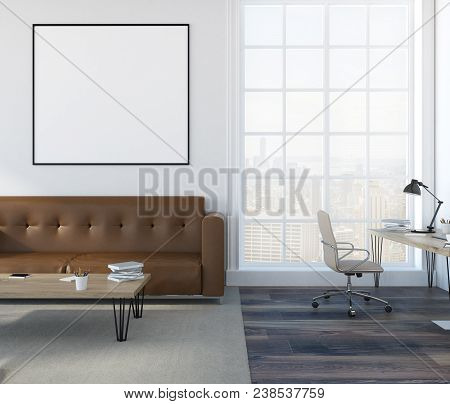 White Wall Living Room Interior With A Soft Brown Sofa, A Coffee Table And A Home Office In The Corn