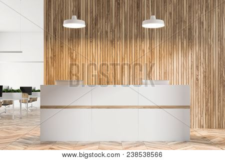 Eco Style Office Interior With White And Wooden Walls, A White Reception In The Foreground And An Op