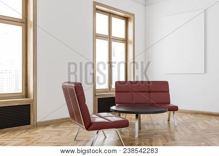 Red Sofa Waiting Area Of An Office, A Hotel Or A Clinic With White Walls, Wooden Window Frames And S