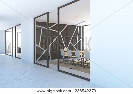 Black Panoramic Boardroom Interior With A Concrete Floor, A Long Wooden Table And White Chairs As Se