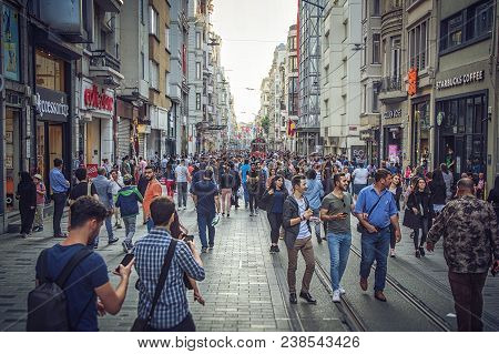 Istanbul, Turkey: Crowds Of People Walking Along Istiklal Avenue, On April 26, 2018 Istiklal Is One