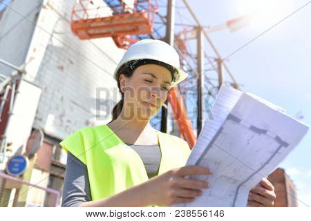 Construction manager woman controlling industrial site