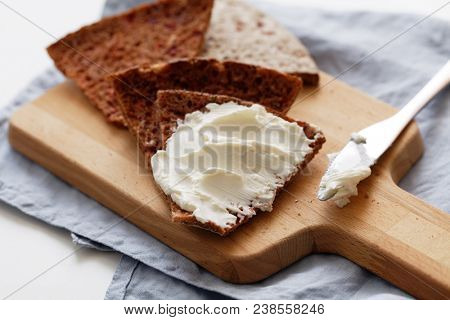 Sandwich with cream cheese on a slice of Finnish bread Reikaleipa