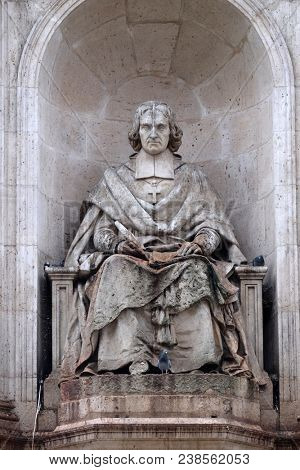 PARIS, FRANCE - JANUARY 04: Fenelon by Francois Lanno. Fountain of the Sacred Orators, Place Saint Sulpice in Paris, France on January 04, 2018.