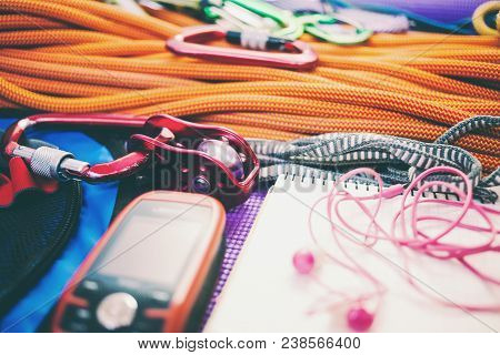 Roller, Rope, Navigator, Carbine And Notepad. Equipment For Mountaineering. Notebook And Equipment F