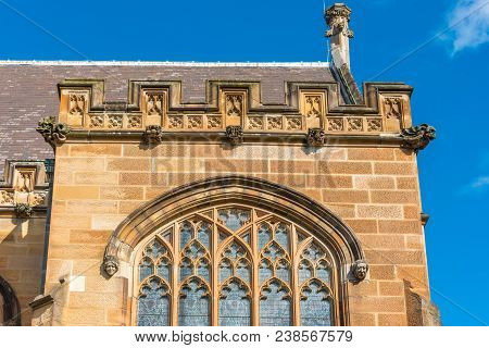 Sandstone Gothic Buildng With Arch Windows And Gothic Decorations