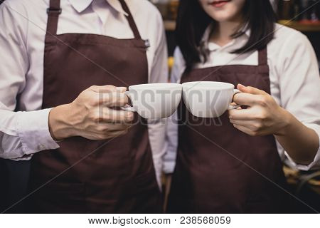 Closeup Hand Barista Holding Coffee Cup In Coffee Shop Counter. Barista Working At Cafe. Working Peo