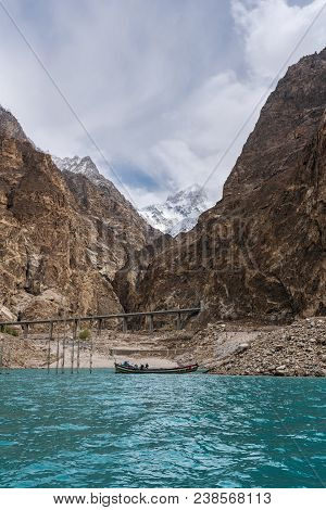 Attabad Lake And Rocky Mountain With Local Boat In Pakistan
