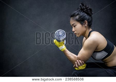 Young Asian Woman Lifting Dumbbell In Weight Training Fitness Gym, Sport Exercise And Muscular Build