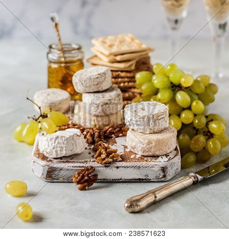 Christmas Cheese Platter, Variety Of French Cheeses, Green Grapes, Walnuts, Honey And Crackers, Squa