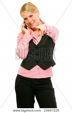 Smiling Business Woman Talking On Cell Phone And Pointing On You