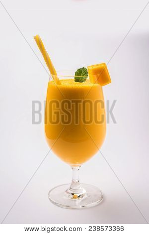 Mango Lassi Or Smoothie In Big Glass With Mint Leaf. Side Angle  Isolated Over Colourful Background.