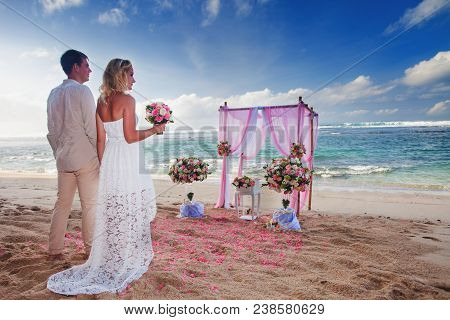 Wedding Couple Just Married At The Beach, Hawaii. Wedding Ceremony In Hawai