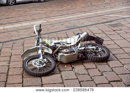Milan , Italy 17 March 2018 : Traffic Accident Of A Motorcycle Fallen To The Ground On The Road .